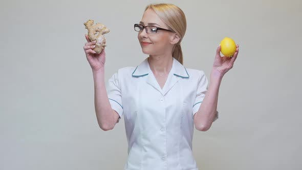 Thumbnail for Nutritionist Doctor Healthy Lifestyle Concept - Holding Ginger Root and Lemon Fruit