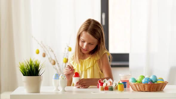 Thumbnail for Happy Girl Coloring Easter Eggs at Home 20