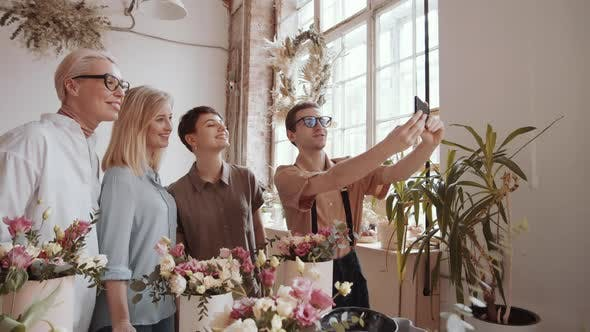 Thumbnail for Male Florist Taking Group Selfie with Cheerful Women in Flower Workshop
