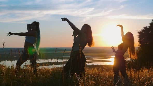 Aerobics in Nature - Three Young Women Dancing on Sunset
