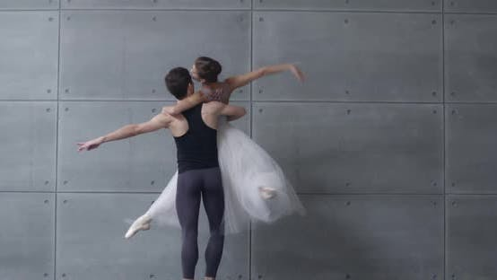 Elegant Couple of Classical Ballet Dancers Dancing on a Gray Background, Romantic Dance of Ballet