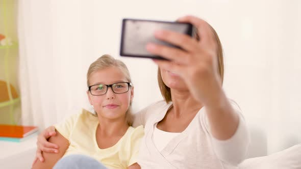 Happy Family Taking Selfie By Smartphone at Home 42