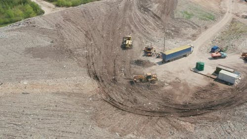 Waste Management Plant. Landfill with the sorting trucks