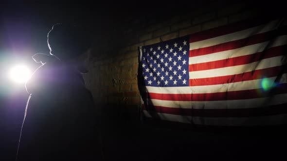Cover Image for A Young Soldier in the Spotlight Looks at the US Flag