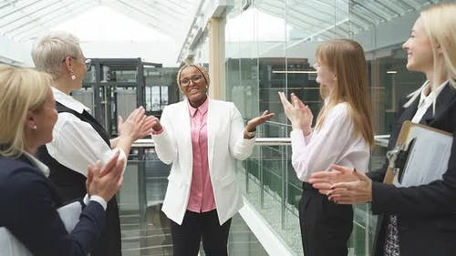 Afro American Woman Get Congratulations By Caucasian Colleagues, Clapping Hands