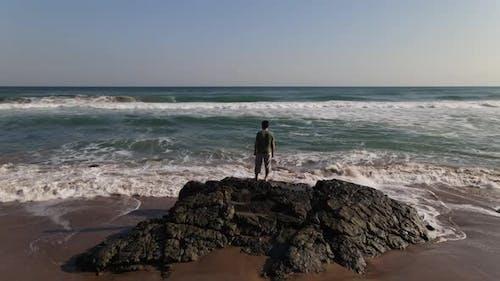 Watching Ocean Waves Rock Aerial View