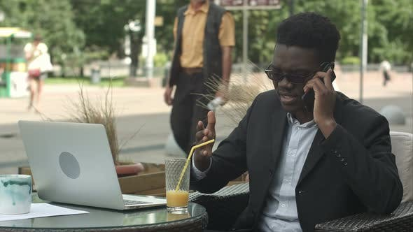 Thumbnail for Afro-American Businessman Negotiating By Phone, Defending His Interests and Opinion