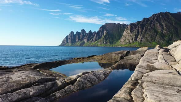 Cover Image for Beautiful Norwegian rocky coast and mountain ridge
