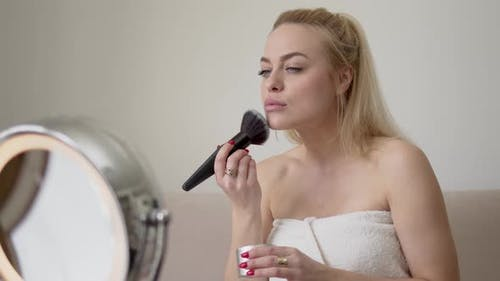 Blond Woman Applying Makeup in Morning