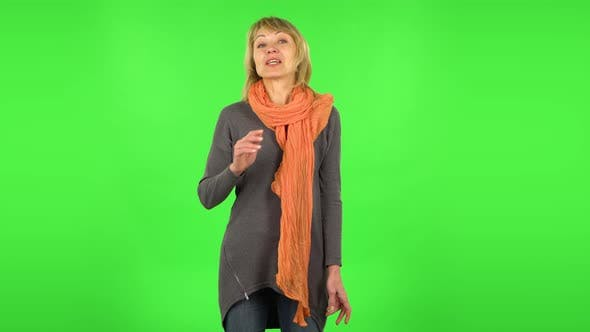 Thumbnail for Middle Aged Blonde Woman Is Talking About Something Then Making a Hush Gesture, Secret