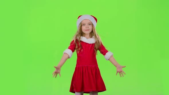 Thumbnail for Baby Girl in Red New Year Costume Is Dancing. Green Screen