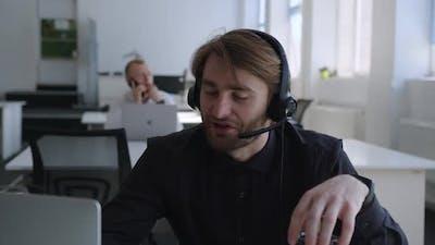 Energetic Man Speaks Online with His Customer