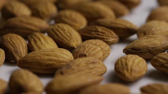 Thumbnail for Cinematic, rotating shot of almonds on a white surface - ALMONDS 014