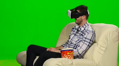 Guy in a Mask Augmented Reality Device. Green Screen