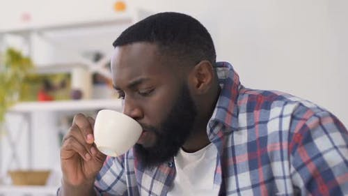 Afro-American Man Drinking Hot Beverage and Feeling Toothache, Sensitive Enamel