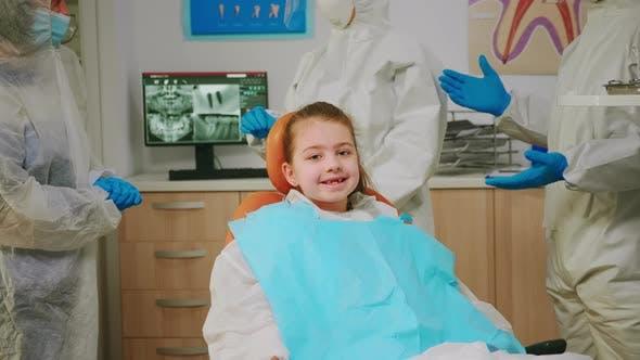 Thumbnail for Close Up of Happy Girl Laughing at Camera Visiting Dentist During Global Pandemic