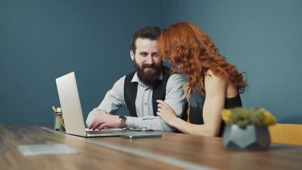 Man and Woman Working Together in the Office