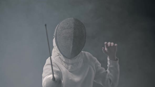 Thumbnail for Fencing Training in the Studio - Young Woman Fencing in the Smoke