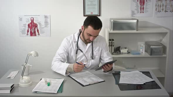 Thumbnail for Male Doctor Work Using Tablet Gadget