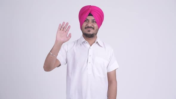 Cover Image for Happy Bearded Indian Sikh Man Wearing Turban and Waving Hand