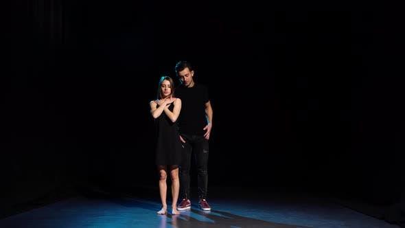 Romantic Choreography Against Black Background in Spotlight at Studio