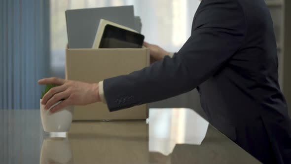 Thumbnail for Company Employee Unpacking, Putting His Stuff From Box Onto Desk, New Position