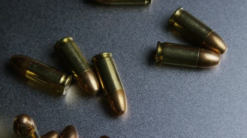 Cinematic rotating shot of bullets on a metallic surface - BULLETS 047