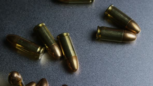 Thumbnail for Cinematic rotating shot of bullets on a metallic surface - BULLETS 047