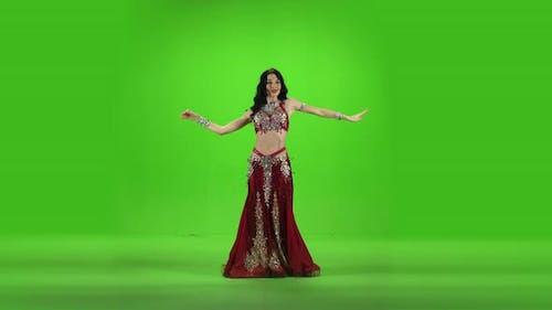 Dancing Belly Dance in Red Dress.