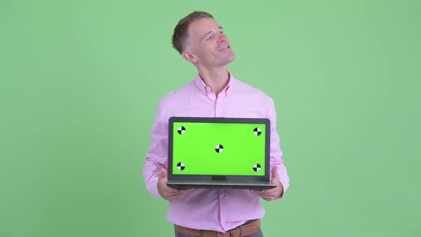 Thumbnail for Happy Businessman Thinking While Showing Laptop
