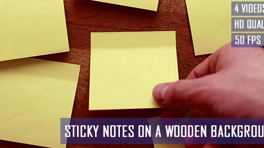 Thumbnail for Sticky Notes On A Wooden Background