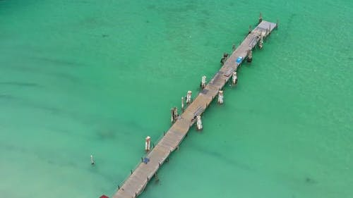 Aerial View From Drone on Caribbean Seashore with Wooden Pier