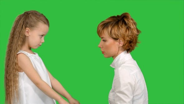 Thumbnail for Mother speaks with her daughter on a Green Screen, Chroma Key