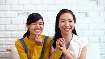 Excited Asian Females Watching TV