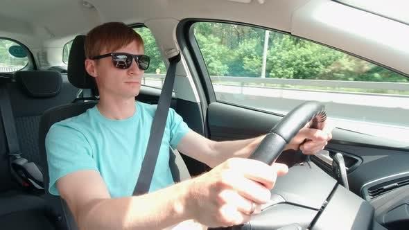 Man In Sunglasses Driving Car