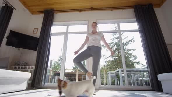 Thumbnail for Woman Doing Yoga on Living Room on Sunny Morning