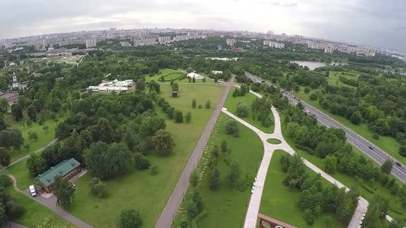 Thumbnail for Flying Over the City with Vast Green Plantations
