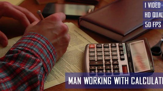 Thumbnail for Man Working With Calculator