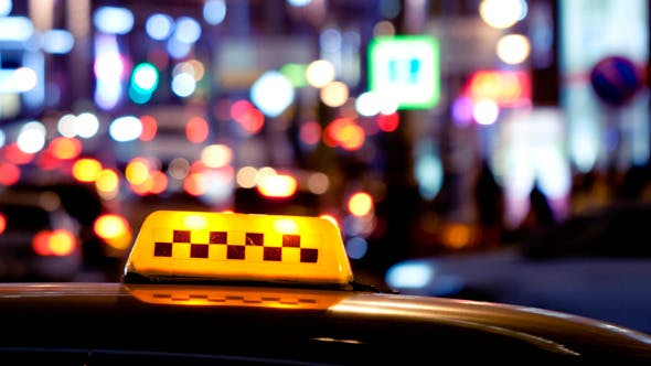 Thumbnail for Timelapse of City Traffic at Night Behind Taxi 2