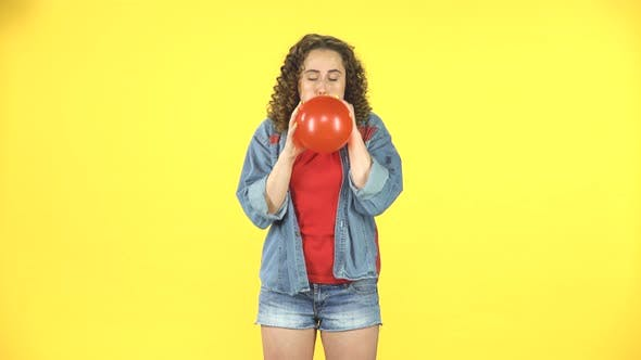 Thumbnail for The Girl Inflates a Red Balloon, Takes in Hand and Releases, the Ball Is Blown Away and Flies Away