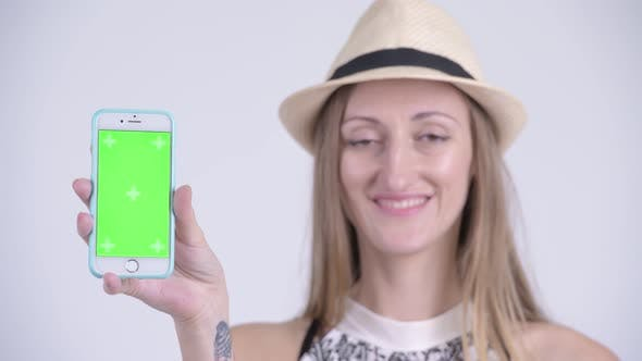 Thumbnail for Face of Happy Blonde Tourist Woman Showing Phone