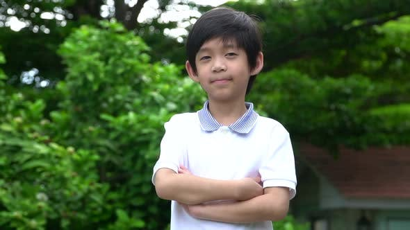 Cute Asian Child Thinking Out Door