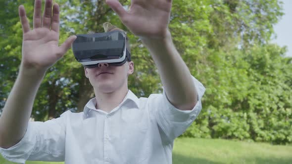 Cover Image for Portrait Young Man Wearing Virtual Reality Headset Playing Video Game Enjoying the Realistic Image