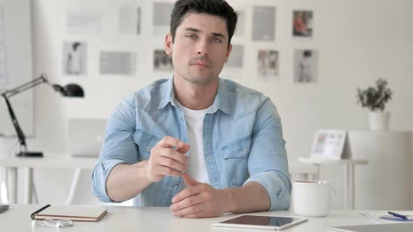 Thumbnail for Denying Gesture by Man Sitting at Workplace