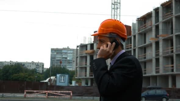Thumbnail for Builder in Helmet Talking on a Smart Phone.