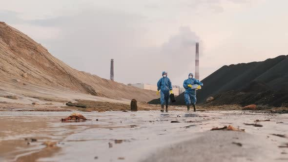 Thumbnail for Ecologists In Protective Costumes In Polluted Town