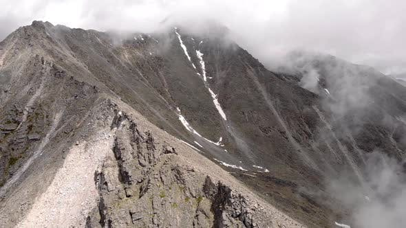 Incredible Aerial Flight Through Clouds Fog to Majestic Epic Dark Mountains