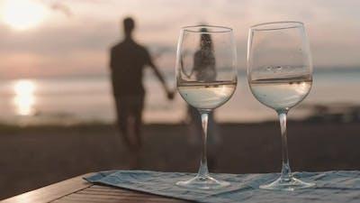 Wine Glasses on Seashore on Sunset