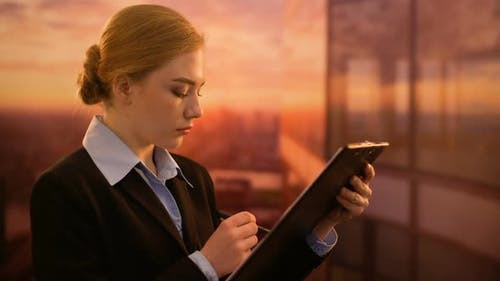 Employee Checking Documents, Working in Sunset Time, Dedication to Favorite Case