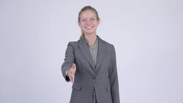 Thumbnail for Young Happy Blonde Businesswoman Giving Handshake
